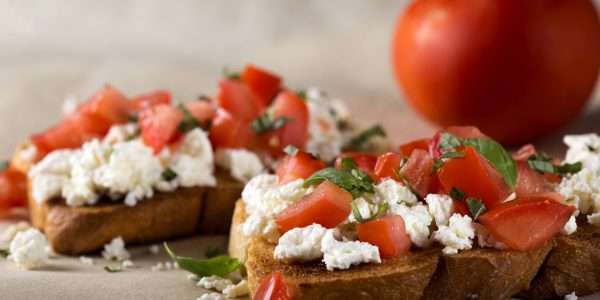 Italian Appetizer Bruschetta with roasted tomatoes, cheese and herbs