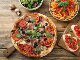 top view slow food pizza pasta with tomato sauce and salad bowl on rustic table